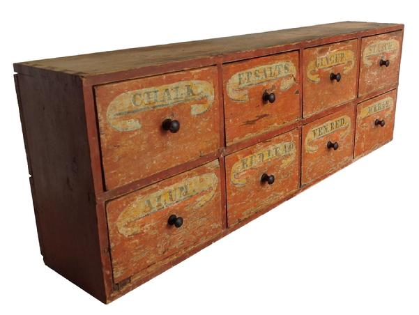 "A411 Early 19th century  Virginia Country Store Apothecary, circa 1820  with the original salmon and mustard paint ,  original hand painted  labels mustard back ground with black lettering on drawers,with such names as Ep. salt, starch , ginger, chalk , red lead, white led.  The drawers are dovetailed also the case, the wood is southern heart pine, with a two board back held in place with square head nails. measurements are: 11 1/2 deep x 20 3/4"" tall x 61"" long"